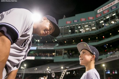 BOSTON, MA - AUGUST 11: Alex Rodriguez #13 of the New York Yankees gives a bat to fan Jacob Doherty, 10, of Wilmington, Massachusetts, following a game against the Boston Red Sox on August 11, 2016 at Fenway Park in Boston, Massachusetts.(Photo by Billie Weiss/Boston Red Sox/Getty Images) *** Local Caption *** Alex Rodriguez; Jacob Doherty
