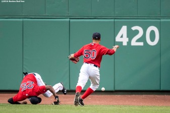 BOSTON, MA - AUGUST 12: Jackie Bradley Jr. #25 of the Boston Red Sox trips while attempting to catch a fly ball as Mookie Betts #50 chases the ball during the first inning of a game against the Arizona Diamondbacks on August 12, 2016 at Fenway Park in Boston, Massachusetts. (Photo by Billie Weiss/Boston Red Sox/Getty Images) *** Local Caption *** Jackie Bradley Jr., Mookie Betts