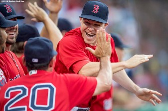 BOSTON, MA - AUGUST 12: Brock Holt #12 of the Boston Red Sox high fives teammates during the first inning of a game against the Arizona Diamondbacks on August 12, 2016 at Fenway Park in Boston, Massachusetts. (Photo by Billie Weiss/Boston Red Sox/Getty Images) *** Local Caption *** Brock Holt