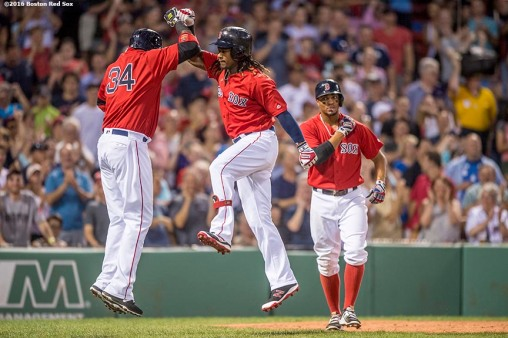 BOSTON, MA - AUGUST 12: Hanley Ramirez #13 of the Boston Red Sox high fives David Ortiz #34 alongside Xander Bogaerts #2 after hitting a three run home run during the second inning of a game against the Arizona Diamondbacks on August 12, 2016 at Fenway Park in Boston, Massachusetts. It was his second three run home run of the game. (Photo by Billie Weiss/Boston Red Sox/Getty Images) *** Local Caption *** Hanley Ramirez; Xander Bogaerts; David Ortiz