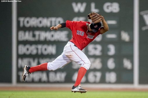 BOSTON, MA - AUGUST 12: Xander Bogaerts #2 of the Boston Red Sox reaches as he attempts to field a ground ball during the fourth inning of a game against the Arizona Diamondbacks on August 12, 2016 at Fenway Park in Boston, Massachusetts. (Photo by Billie Weiss/Boston Red Sox/Getty Images) *** Local Caption *** Xander Bogaerts