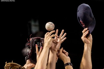 BOSTON, MA - AUGUST 12: Fans reach for a foul ball during a game between the Boston Red Sox and the Arizona Diamondbacks on August 12, 2016 at Fenway Park in Boston, Massachusetts. (Photo by Billie Weiss/Boston Red Sox/Getty Images) *** Local Caption ***