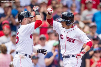 BOSTON, MA - AUGUST 14: Mookie Betts #50 of the Boston Red Sox high fives Dustin Pedroia #15 after hitting a two run home run during the first inning of a game against the Arizona Diamondbacks on August 14, 2016 at Fenway Park in Boston, Massachusetts. (Photo by Billie Weiss/Boston Red Sox/Getty Images) *** Local Caption *** Mookie Betts; Dustin Pedroia