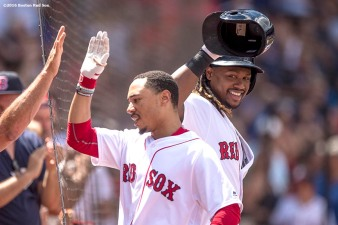 BOSTON, MA - AUGUST 14: Mookie Betts #50 of the Boston Red Sox has his helmet removed by Hanley Ramirez #13 after hitting a three run home run during the second inning of a game against the Arizona Diamondbacks on August 14, 2016 at Fenway Park in Boston, Massachusetts. It was his second home run of the game. (Photo by Billie Weiss/Boston Red Sox/Getty Images) *** Local Caption *** Mookie Betts; Hanley Ramirez