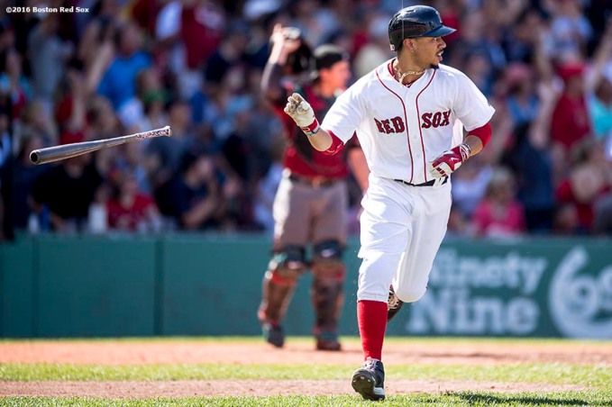 BOSTON, MA - AUGUST 14: Mookie Betts #50 of the Boston Red Sox tosses his bat after hitting a home run during the fifth inning of a game against the Arizona Diamondbacks on August 14, 2016 at Fenway Park in Boston, Massachusetts. It was his third home run of the day. (Photo by Billie Weiss/Boston Red Sox/Getty Images) *** Local Caption *** Mookie Betts