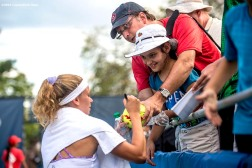 August 20, 2016, New Haven, Connecticut: Camila Giorgi of Italy signs autographs after a victory during a qualifying match on Day 2 of the 2016 Connecticut Open at the Yale University Tennis Center on Saturday, August 20, 2016 in New Haven, Connecticut. (Photo by Billie Weiss/Connecticut Open)
