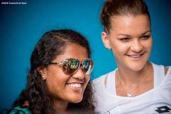August 21, 2016, New Haven, Connecticut: Agnieszka Radwanska of Poland poses with a fan during WTA All-Access Hour on Day 3 of the 2016 Connecticut Open at the Yale University Tennis Center on Sunday, August 21, 2016 in New Haven, Connecticut. (Photo by Billie Weiss/Connecticut Open)