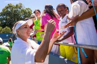 August 22, 2016, New Haven, Connecticut: Elena Vesnina of Russia signs autographs for fans after winning a match on Day 4 of the 2016 Connecticut Open at the Yale University Tennis Center on Monday August 22, 2016 in New Haven, Connecticut. (Photo by Billie Weiss/Connecticut Open)