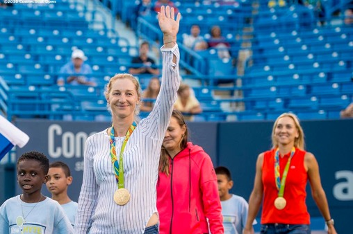 August 22, 2016, New Haven, Connecticut: Ekaterina Makarova and Elena Vesnina are introduced as they wear their Olympic gold medals during the Opening Ceremonies on Day 4 of the 2016 Connecticut Open at the Yale University Tennis Center on Monday August 22, 2016 in New Haven, Connecticut. (Photo by Billie Weiss/Connecticut Open)