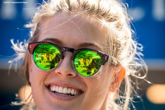 August 23, 2016, New Haven, Connecticut: Eugenie Bouchard of Canada rides a spin bike at the the Yale New Haven Health booth during Day 5 of the 2016 Connecticut Open at the Yale University Tennis Center on Tuesday, August 23, 2016 in New Haven, Connecticut. (Photo by Billie Weiss/Connecticut Open)