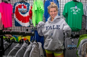 August 23, 2016, New Haven, Connecticut: Eugenie Bouchard of Canada tries on a Yale University hooded sweatshirt at the Pro Shop during Day 5 of the 2016 Connecticut Open at the Yale University Tennis Center on Tuesday, August 23, 2016 in New Haven, Connecticut. (Photo by Billie Weiss/Connecticut Open)