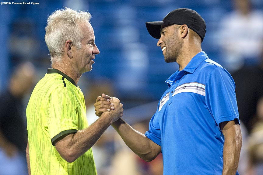 August 25, 2016, New Haven, Connecticut: John McEnroe and James Blake shake hands during the Men's Legends Event on Day 7 of the 2016 Connecticut Open at the Yale University Tennis Center on Thursday, August 25, 2016 in New Haven, Connecticut. (Photo by Billie Weiss/Connecticut Open)