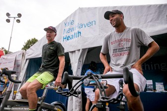 August 25, 2016, New Haven, Connecticut: John McEnroe and James Blake ride the spin Bikes at the Yale New Haven Health booth during the Men's Legends Event on Day 7 of the 2016 Connecticut Open at the Yale University Tennis Center on Thursday, August 25, 2016 in New Haven, Connecticut. (Photo by Billie Weiss/Connecticut Open)