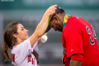 BOSTON, MA - AUGUST 26: Olympic gymnast Aly Raisman puts a medal on David Ortiz #34 of the Boston Red Sox before throwing out a ceremonial first pitch before a game against the Kansas City Royals on August 26, 2016 at Fenway Park in Boston, Massachusetts. (Photo by Billie Weiss/Boston Red Sox/Getty Images) *** Local Caption *** David Ortiz; Aly Raisman