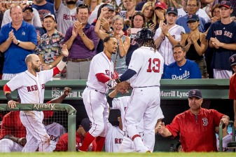 BOSTON, MA - AUGUST 27: Hanley Ramirez #13 of the Boston Red Sox high fives Mookie Betts #50 after hitting a solo home run during the fifth inning of a game against the Kansas City Royals on August 27, 2016 at Fenway Park in Boston, Massachusetts. Betts and Ramirez hit back to back home runs. (Photo by Billie Weiss/Boston Red Sox/Getty Images) *** Local Caption *** Hanley Ramirez; Mookie Betts
