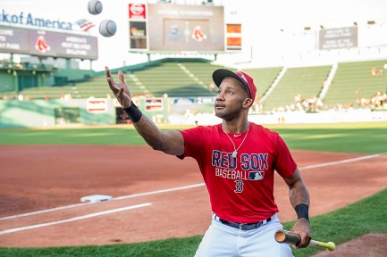 BOSTON, MA - AUGUST 28: Chris Young #30 of the Boston Red Sox attempts to catch two baseballs at once before a game against the Kansas City Royals on August 28, 2016 at Fenway Park in Boston, Massachusetts. (Photo by Billie Weiss/Boston Red Sox/Getty Images) *** Local Caption *** Chris Young