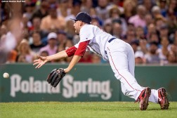 BOSTON, MA - AUGUST 28: Matt Barnes #68 of the Boston Red Sox dives as he tosses a ground ball toward home plate during the sixth inning of a game against the Kansas City Royals on August 28, 2016 at Fenway Park in Boston, Massachusetts. (Photo by Billie Weiss/Boston Red Sox/Getty Images) *** Local Caption *** Matt Barnes