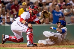 BOSTON, MA - AUGUST 28: Lorenzo Cain #6 of the Kansas City Royals evades the tag of Sandy Leon #3 of the Boston Red Sox to score during the sixth inning of a game on August 28, 2016 at Fenway Park in Boston, Massachusetts. (Photo by Billie Weiss/Boston Red Sox/Getty Images) *** Local Caption *** Lorenzo Cain; Sandy Leon