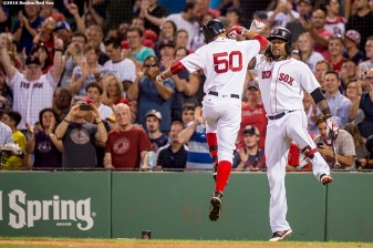BOSTON, MA - AUGUST 29: Mookie Betts #50 of the Boston Red Sox high fives Hanley Ramirez #13 after hitting a solo home run during the second inning of a game against the Tampa Bay Rays on August 29, 2016 at Fenway Park in Boston, Massachusetts. (Photo by Billie Weiss/Boston Red Sox/Getty Images) *** Local Caption *** Mookie Betts; Hanley Ramirez