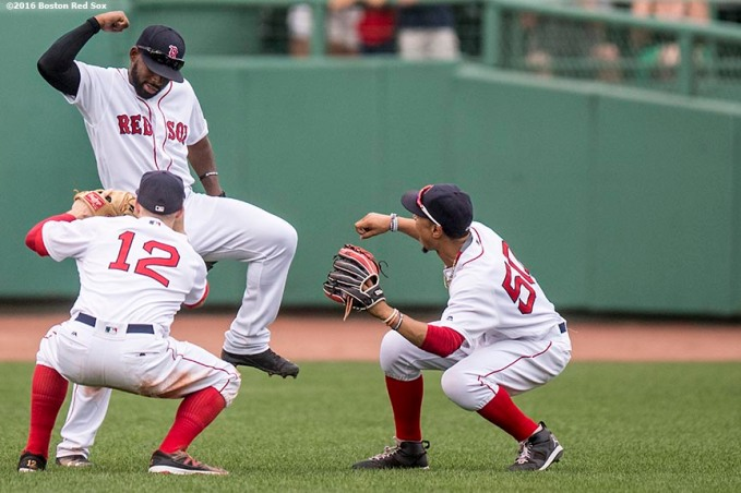 BOSTON, MA - AUGUST 31: Brock Holt #12, Jackie Bradley Jr. #25, and Mookie Betts #50 of the Boston Red Sox celebrate a victory against the Tampa Bay Rays on August 31, 2016 at Fenway Park in Boston, Massachusetts. (Photo by Billie Weiss/Boston Red Sox/Getty Images) *** Local Caption *** Brock Holt; Jackie Bradley Jr.; Mookie Betts