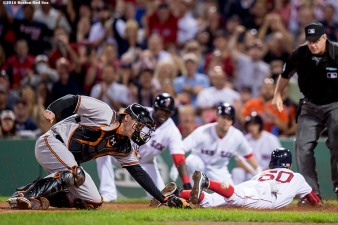 BOSTON, MA - SEPTEMBER 12: Mookie Betts #50 of the Boston Red Sox slides as he evades the tag of Matt Wieters #32 of the Baltimore Orioles to score during the first inning of a game on September 12, 2016 at Fenway Park in Boston, Massachusetts. (Photo by Billie Weiss/Boston Red Sox/Getty Images) *** Local Caption *** Mookie Betts; Matt Wieters