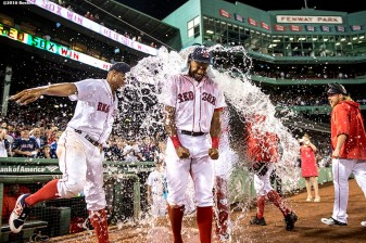 BOSTON, MA - SEPTEMBER 12: Chris Young #30 of the Boston Red Sox is given a Powerade shower by Xander Bogaerts #2 following a game against the Baltimore Orioles on September 12, 2016 at Fenway Park in Boston, Massachusetts. (Photo by Billie Weiss/Boston Red Sox/Getty Images) *** Local Caption *** Chris Young