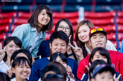 BOSTON, MA - SEPTEMBER 13: Koji Uehara #19 of the Boston Red Sox poses with fans before a game against the Baltimore Orioles on September 13, 2016 at Fenway Park in Boston, Massachusetts. (Photo by Billie Weiss/Boston Red Sox/Getty Images) *** Local Caption *** Koji Uehara