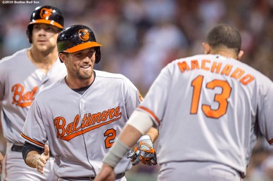 BOSTON, MA - SEPTEMBER 13: J.J. Hardy #2 of the Baltimore Orioles reacts with Manny Machado #13 after hitting a three run home run during the second inning of a game against the Boston Red Sox on September 13, 2016 at Fenway Park in Boston, Massachusetts. (Photo by Billie Weiss/Boston Red Sox/Getty Images) *** Local Caption *** J.J. Hardy; Manny Machado