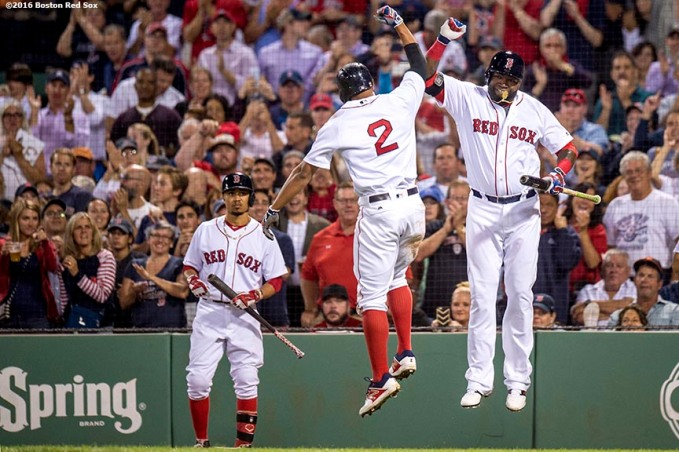 BOSTON, MA - SEPTEMBER 13: Xander Bogaerts #2 of the Boston Red Sox reacts with David Ortiz #34 after hitting a solo home run during the fifth inning of a game against the Baltimore Orioles on September 13, 2016 at Fenway Park in Boston, Massachusetts. (Photo by Billie Weiss/Boston Red Sox/Getty Images) *** Local Caption *** Xander Bogaerts; David Ortiz
