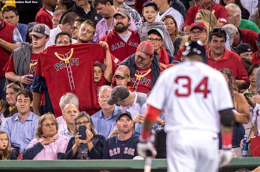 BOSTON, MA - SEPTEMBER 13: A fan holds a t shirt as Dustin Pedroia #34 of the Boston Red Sox walks to the dugout after striking out during the seventh inning of a game against the Baltimore Orioles on September 13, 2016 at Fenway Park in Boston, Massachusetts. (Photo by Billie Weiss/Boston Red Sox/Getty Images) *** Local Caption *** David Ortiz