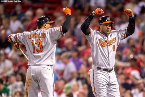 BOSTON, MA - SEPTEMBER 13: Jonathan Schoop #6 of the Baltimore Orioles reacts with Manny Machado #13 after hitting a solo home run during the ninth inning of a game against the Boston Red Sox on September 13, 2016 at Fenway Park in Boston, Massachusetts. (Photo by Billie Weiss/Boston Red Sox/Getty Images) *** Local Caption *** Manny Machado; Jonathan Schoop
