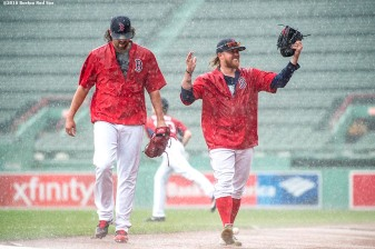 BOSTON, MA - SEPTEMBER 14: Robbie Ross Jr.#28 and Heath Hembree #37 of the Boston Red Sox react as they get caught in a rain storm before a game against the Baltimore Orioles on September 14, 2016 at Fenway Park in Boston, Massachusetts. (Photo by Billie Weiss/Boston Red Sox/Getty Images) *** Local Caption *** Robbie Ross Jr.; Heath Hembree