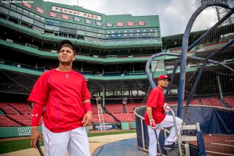 BOSTON, MA - SEPTEMBER 14: Yoan Moncada #65 and Mookie Betts $50 of the Boston Red Sox look on as they take batting practice before a game against the Baltimore Orioles on September 14, 2016 at Fenway Park in Boston, Massachusetts. (Photo by Billie Weiss/Boston Red Sox/Getty Images) *** Local Caption *** Yoan Moncada; Mookie Betts