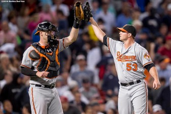 BOSTON, MA - SEPTEMBER 14: Matt Wieters #32 and Zach Britton #53 of the Baltimore Orioles celebrate a victory against the Boston Red Sox on September 14, 2016 at Fenway Park in Boston, Massachusetts. (Photo by Billie Weiss/Boston Red Sox/Getty Images) *** Local Caption *** Matt Wieters; Zach Britton
