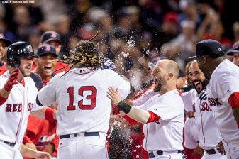 BOSTON, MA - SEPTEMBER 15: Hanley Ramirez #13 of the Boston Red Sox is mobbed by teammates after hitting a walk off three run home run during the ninth inning of a game against the New York Yankees on September 15, 2016 at Fenway Park in Boston, Massachusetts. (Photo by Billie Weiss/Boston Red Sox/Getty Images) *** Local Caption *** Hanley Ramirez