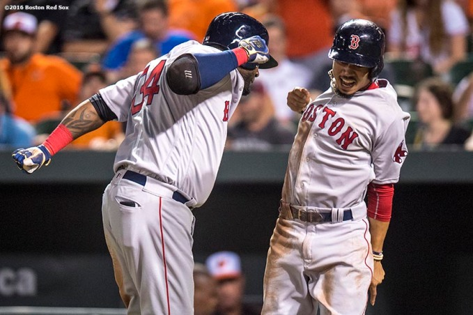 BALTIMORE, MD - SEPTEMBER 20: David Ortiz #34 of the Boston Red Sox reacts with Mookie Betts #50 after hitting a three run home run during the seventh inning of a game against the Baltimore Orioles on September 20, 2016 at Oriole Park at Camden Yards in Baltimore, Maryland. (Photo by Billie Weiss/Boston Red Sox/Getty Images) *** Local Caption *** David Ortiz; Mookie Betts