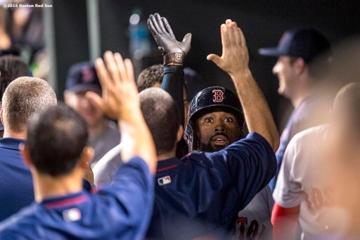 BALTIMORE, MD - SEPTEMBER 20: Jackie Bradley Jr. #25 of the Boston Red Sox high fives teammates after hitting a solo home run during the fourth inning of a game against the Baltimore Orioles on September 20, 2016 at Oriole Park at Camden Yards in Baltimore, Maryland. (Photo by Billie Weiss/Boston Red Sox/Getty Images) *** Local Caption *** Jackie Bradley Jr.