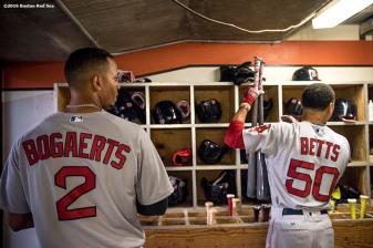 BALTIMORE, MD - SEPTEMBER 20: Xander Bogaerts #2 and Mookie Betts #50 of the Boston Red Sox pick up their bats before a game against the Baltimore Orioles on September 20, 2016 at Oriole Park at Camden Yards in Baltimore, Maryland. (Photo by Billie Weiss/Boston Red Sox/Getty Images) *** Local Caption *** Mookie Betts; Xander Bogaerts