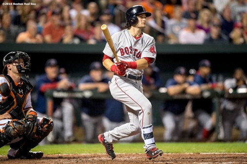 BALTIMORE, MD - SEPTEMBER 21: Andrew Benintendi #40 of the Boston Red Sox hits a three run home run during the sixth inning of a game against the Baltimore Orioles on September 21, 2016 at Oriole Park at Camden Yards in Baltimore, Maryland. (Photo by Billie Weiss/Boston Red Sox/Getty Images) *** Local Caption *** Andrew Benintendi