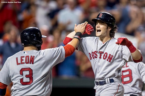 BALTIMORE, MD - SEPTEMBER 21: Andrew Benintendi #40 of the Boston Red Sox high fives Sandy leon #3 after hitting a three run home run during the sixth inning of a game against the Baltimore Orioles on September 21, 2016 at Oriole Park at Camden Yards in Baltimore, Maryland. (Photo by Billie Weiss/Boston Red Sox/Getty Images) *** Local Caption *** Andrew Benintendi; Sandy Leon
