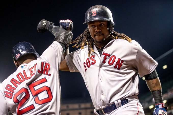 BALTIMORE, MD - SEPTEMBER 22: Hanley Ramirez #13 of the Boston Red Sox high fives Jackie Bradley Jr. #25 after hitting a solo home run during the seventh inning of a game against the Baltimore Orioles on September 22, 2016 at Oriole Park at Camden Yards in Baltimore, Maryland. (Photo by Billie Weiss/Boston Red Sox/Getty Images) *** Local Caption *** Hanley Ramirez; Jackie Bradley Jr.