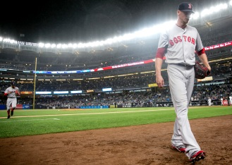 NEW YORK, NY - SEPTEMBER 28: Clay Buchholz #11 of the Boston Red Sox walks toward the dugout during the first inning of a game against the New York Yankees on September 28, 2016 at Yankee Stadium in the Bronx borough of New York City. (Photo by Billie Weiss/Boston Red Sox/Getty Images) *** Local Caption *** Clay Buchholz