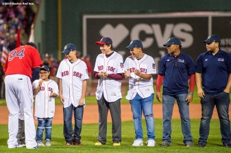 BOSTON, MA - SEPTEMBER 30: David Ortiz #34 of the Boston Red Sox greets beneficiaries of the David Ortiz Children's Fund during a retirement tribute ceremony before a game against the Toronto Blue Jays on September 30, 2016 at Fenway Park in Boston, Massachusetts. (Photo by Billie Weiss/Boston Red Sox/Getty Images) *** Local Caption *** David Ortiz