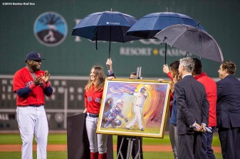 BOSTON, MA - SEPTEMBER 30: David Ortiz #34 of the Boston Red Sox reacts as he is presented with a painting by artist Peter Max during a retirement tribute ceremony before a game against the Toronto Blue Jays on September 30, 2016 at Fenway Park in Boston, Massachusetts. (Photo by Billie Weiss/Boston Red Sox/Getty Images) *** Local Caption *** David Ortiz; Peter Max