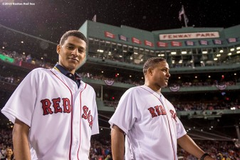 BOSTON, MA - SEPTEMBER 30: Joaquin Maldonado Mendoza, a recipient of a heart surgery via the David Ortiz Children's Fund, is escorted to the mound to throw a ceremonial first pitch by Roberto Clemente Jr. during a retirement tribute ceremony for David Ortiz #34 of the Boston Red Sox before a game against the Toronto Blue Jays on September 30, 2016 at Fenway Park in Boston, Massachusetts. (Photo by Billie Weiss/Boston Red Sox/Getty Images) *** Local Caption *** Joaquin Maldonado Mendoza; Roberto Clemente Jr.
