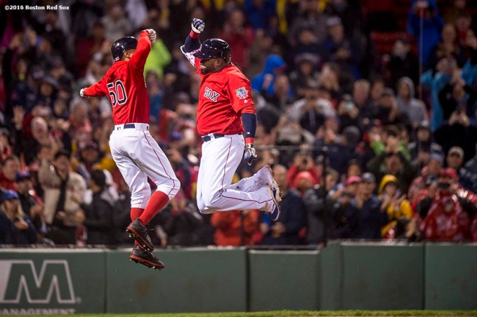 BOSTON, MA - SEPTEMBER 30: David Ortiz #34 of the Boston Red Sox high fives Mookie Betts #50 after hitting a go ahead two run home run during the seventh inning of a game against the Toronto Blue Jays on September 30, 2016 at Fenway Park in Boston, Massachusetts. (Photo by Billie Weiss/Boston Red Sox/Getty Images) *** Local Caption *** David Ortiz; Mookie Betts