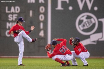 BOSTON, MA - SEPTEMBER 30: Andrew Benintendi #40, Mookie Betts #50, and Jackie Bradley Jr. #25 of the Boston Red Sox celebrate a victory against the Toronto Blue Jays on September 30, 2016 at Fenway Park in Boston, Massachusetts. (Photo by Billie Weiss/Boston Red Sox/Getty Images) *** Local Caption *** Andrew Benintendi; Mookie Betts; Jackie Bradley Jr.
