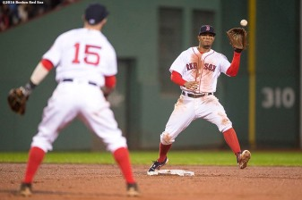 BOSTON, MA - OCTOBER 1: Dustin Pedroia #15 and Xander Bogaerts #2 of the Boston Red Sox turn a double play during the sixth inning of a game against the Toronto Blue Jays on October 1, 2016 at Fenway Park in Boston, Massachusetts. (Photo by Billie Weiss/Boston Red Sox/Getty Images) *** Local Caption *** Dustin Pedroia; Xander Bogaerts