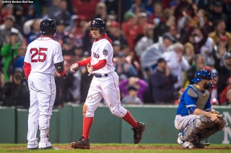 BOSTON, MA - OCTOBER 1: Mookie Betts #50 of the Boston Red Sox high fives Jackie Bradley Jr. #25 after scoring on a balk during the eighth inning of a game against the Toronto Blue Jays on October 1, 2016 at Fenway Park in Boston, Massachusetts. (Photo by Billie Weiss/Boston Red Sox/Getty Images) *** Local Caption *** Mookie Betts; Jackie Bradley Jr.