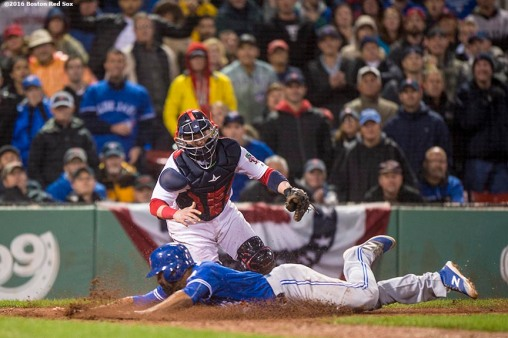BOSTON, MA - OCTOBER 1: Dalton Pompey #23 of the Toronto Blue Jays evades the tag of Christian Vazquez #3 of the Boston Red Sox as he scores during the ninth inning of a game on October 1, 2016 at Fenway Park in Boston, Massachusetts. (Photo by Billie Weiss/Boston Red Sox/Getty Images) *** Local Caption *** Dalton Pompey; Christian Vazquez